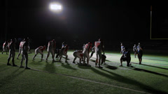 Wide moving camera shot of a football player missing a pass from his quarterback - stock footage