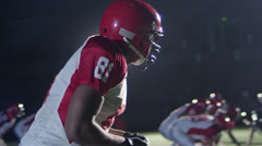 Close up tracking shot of a football player catching a pass while being defended - stock footage