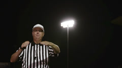 A football referee makes a personal foul penalty hand gesture Stock Footage