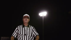 A football referee makes a personal foul hand gesture - stock footage