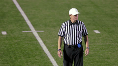Stock Video Footage of Three football referees discuss a offsides penalty call