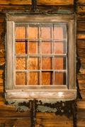 Run down ruin boarded up house plywood window panes Stock Photos