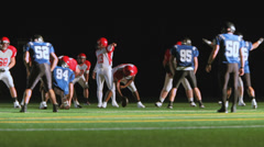 A football team runs a running play and the carrier gains many yards Stock Footage