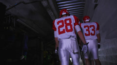 A football players walking down the tunnel to the field before a game Stock Footage