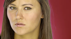 Attractive blue-eyed woman looks at the camera Stock Footage