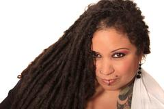 tattooed woman  with piercings and dreadlocks - stock photo