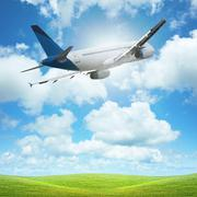 Jet plane over the field of green Stock Photos