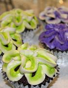 Chocolate Cupcakes with Decorative Green and Purple Frosting Stock Photos