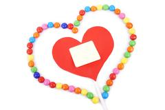 Heart with copy space framed with colorful candy Stock Photos