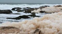 Sea foam on an amazing winter shore Stock Footage