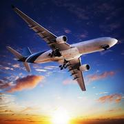 jet cruising at sunset - stock photo