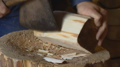 chopping a block of wood - model for a wooden shoe - stock footage