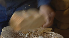Trimming a block of wood - model for a wooden shoe Stock Footage