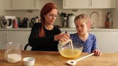 Baking cupcakes adding milk Stock Footage