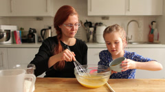 Baking cupcakes adding melted butter Stock Footage
