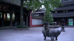 Pan to a temple and Buddha Wenshu Monastery (Manjushri Monastery) Stock Footage