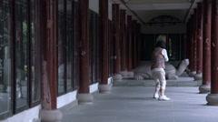 Elderly woman doing Tai chi at Wenshu Monastery Stock Footage