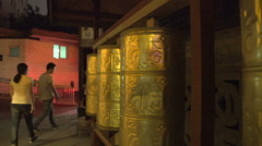 Pan from prayer wheels to book store in the old shopping street Stock Footage