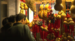 Pan from Traditional Chinese Gourd to the Crowded Jin li street in Chengdu - stock footage