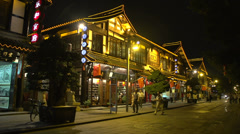 Old shopping streets next to monastery Wenshu Monastery at night Stock Footage