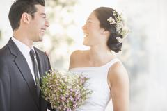 Newlywed couple laughing Stock Photos