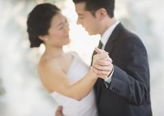 Newlywed couple dancing at wedding reception Stock Photos