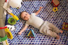 Caucasian newborn laying in crib Stock Photos
