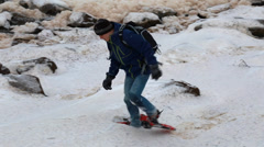 Hiker in snowshoes in winter storm Stock Footage