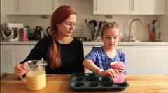 Baking cupcakes preparing the baking tray Stock Footage