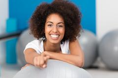 Stock Photo of beautiful young african american lady in a gym