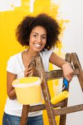 African american woman doing redecorating Stock Photos