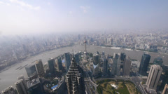Aerial view of high-rise buildings with river in Shanghai,China,time lapse. Stock Footage