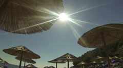 Beach Reed Parasols Against The Sun Stock Footage