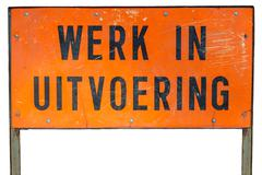 dutch under construction sign isolated on white - stock photo