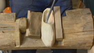 Stock Video Footage of scooping, scraping out a wooden shoe - close up