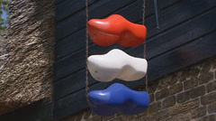3 painted wooden shoes as sign, home decoration in the colours of the Dutch flag Stock Footage