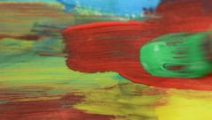 Painting with a paintbrush with red and green color on paper Stock Footage
