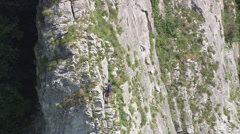 Climber on rock face Stock Footage