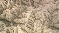 Aerial shot of Badlands National Park in South Dakota abstract rock textures Stock Footage