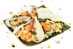 risotto with seafood, mediterranean and japanese cuisine fusion - stock photo
