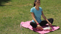 Young beautiful woman stretching outdoors Stock Footage