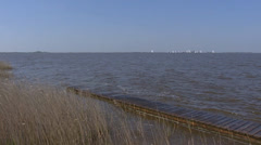 Hold + pan Lake of Sloten with sails in background Stock Footage