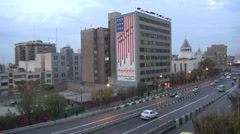 Iran Tehran 'Down with the USA' building contrasts with church Stock Footage