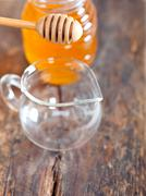 natural honey with a clean dipper - stock photo