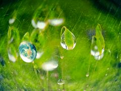 green energy concept, fresh earth in a water drop - stock illustration