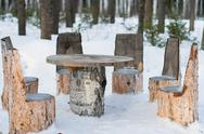 Stock Photo of Table and chairs made of tree trunks