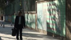 Tehran, former US Embassy, hostage crisis scene 1979, Iran, man walking - stock footage