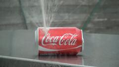 Coca Cola can bursting in slow-mo - stock footage