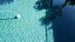 Patient auto-cleaning of pool - stock footage