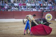 Stock Photo of bullfighter julian lopez el juli bullfighting with a crutch in a beautiful pass